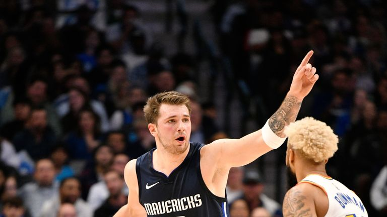 Luka Doncic calls for a play in Dallas' rout of Golden State