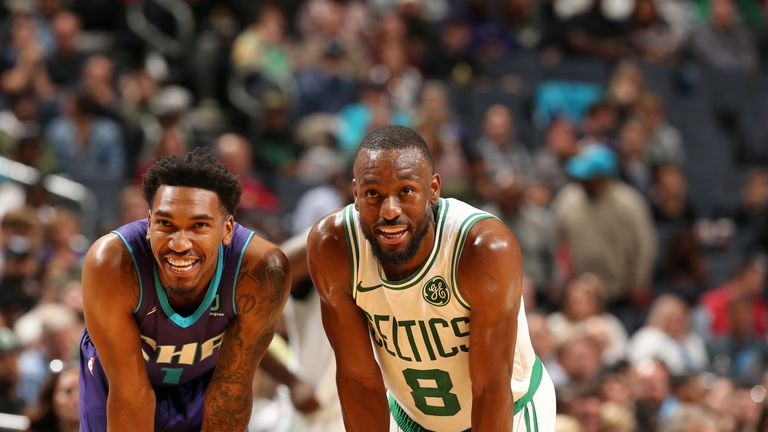 Former team-mates Malik Monk and Kemba Walker share a laugh in Boston's win over Charlotte