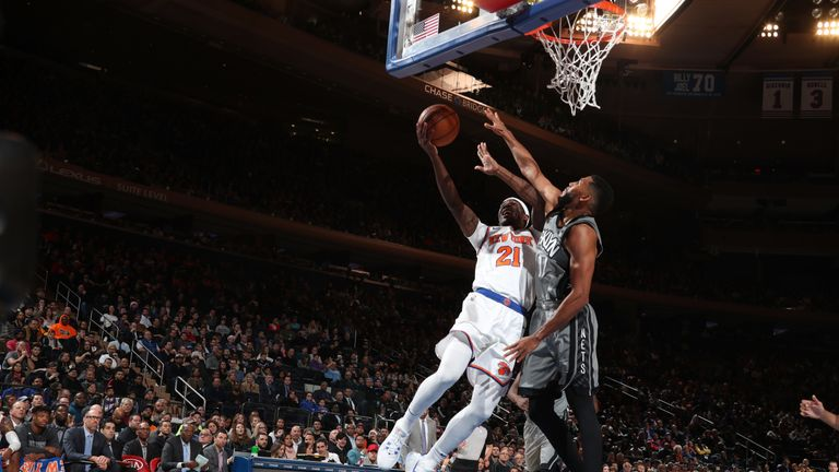 Damyean Dotson elevates to the rim against Brooklyn