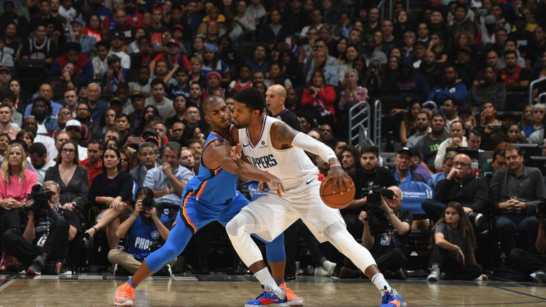 Paul George is guarded by Chris Paul during the Clippers' win over the Thunder