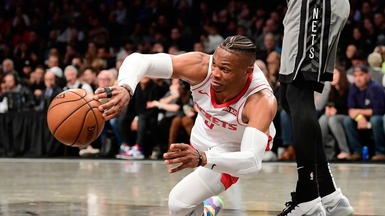 Russell Westbrook dives  for a loose ball against Brooklyn