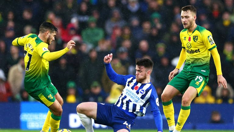 Brighton's Aaron Connolly tackles Emiliano Buendia of Norwich City