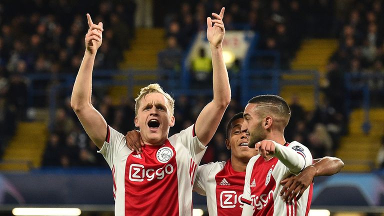 Donny Van de Beek (L) celebrates with Ajax team-mates after scoring their fourth goal against Chelsea