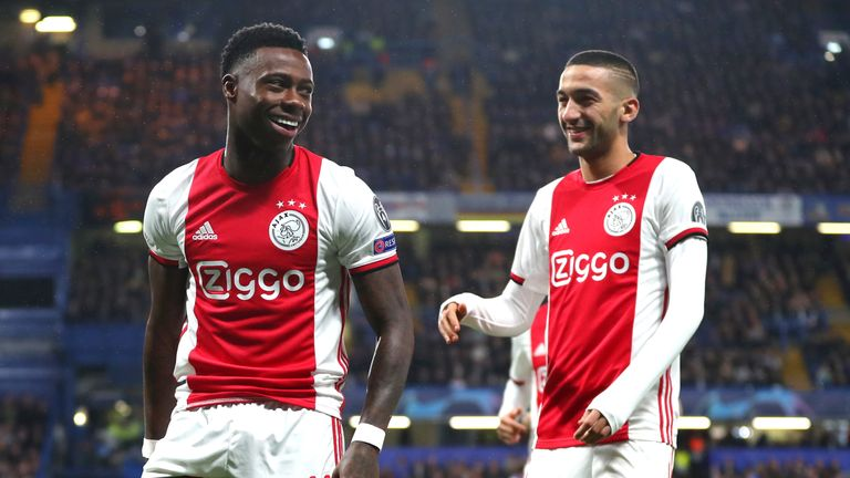 Quincy Promes and Hakim Ziyech celebrate as Ajax went 2-1 ahead at Stamford Bridge