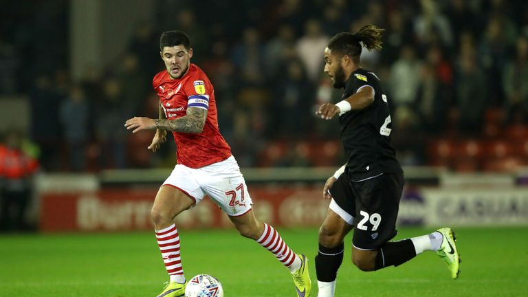 Barnsley's Alex Mowatt (left) and Bristol City's Ashley Williams battle for the ball