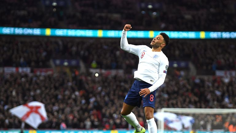 Alex Oxlade-Chamberlain celebrates after scoring England's opener