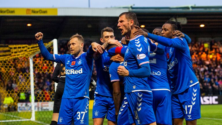 Morelos celebrates with team-mates after scoring his side's second