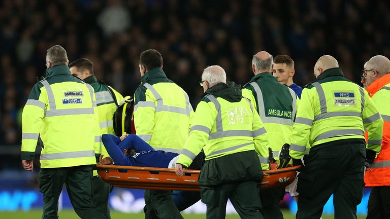 Everton's Andre Gomes is stretchered off injured against Tottenham