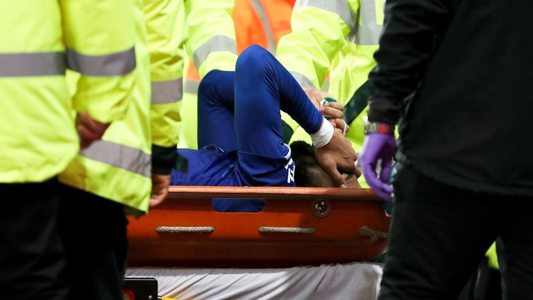Everton's Andre Gomes was carried off the field by medical staff at Goodison Park
