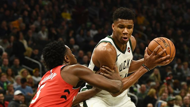 Giannis Antetokounmpo of the Milwaukee Bucks is defended by OG Anunoby of the Toronto Raptors
