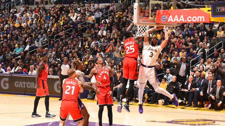 Anthony Davis of the Los Angeles Lakers drives to the basket against the Toronto Raptors