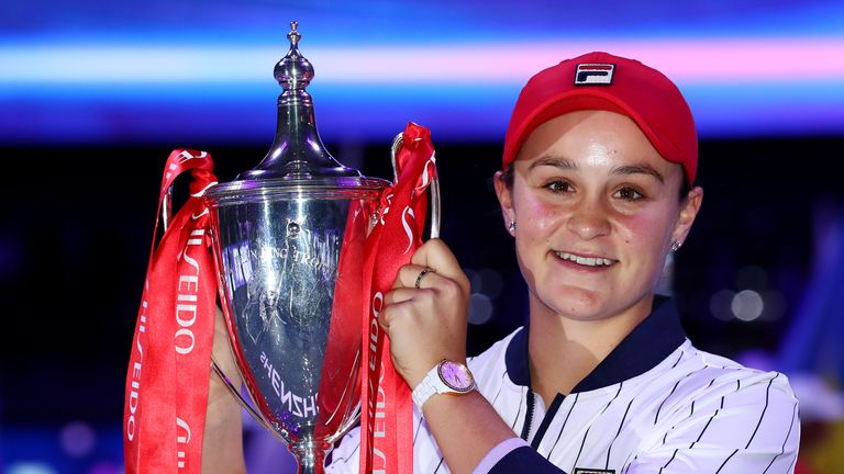 Ashleigh Barty celebrates with the Billie Jean King trophy after winning the WTA Finals