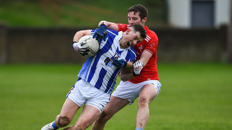 Ryan Basquel of Ballyboden St Enda's in action against Kevin Carr of Newtown Blues