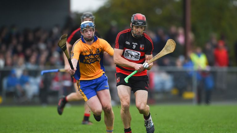 Shane O'Sullivan of Ballygunner in action against Conor Deasy of Sixmilebridge