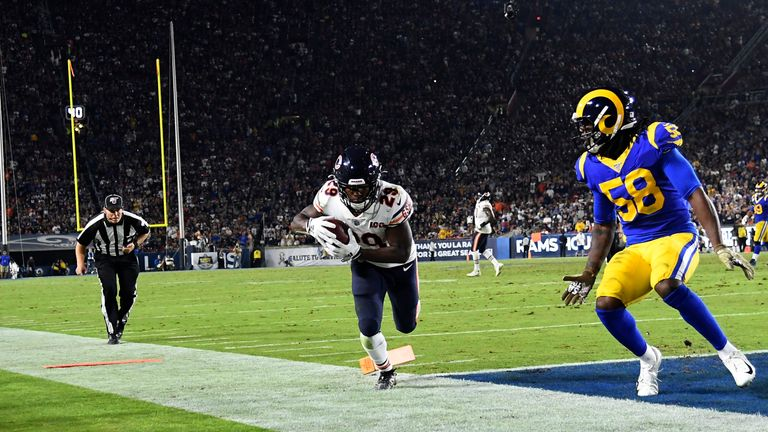 Tarik Cohen of the Chicago Bears scores a touchdown against Cory Littleton of the Los Angeles Rams