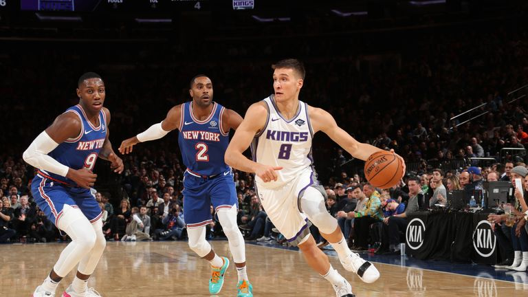 Bogdan Bogdanovic of the Sacramento Kings handles the ball against the New York Knicks