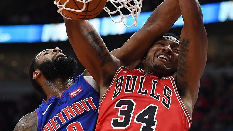 Wendell Carter Jr. of the Chicago Bulls dunks against Andre Drummond of the Detroit Pistons