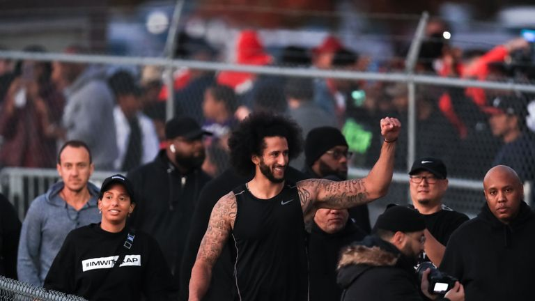 Colin Kaepernick visits with fans following his NFL workout