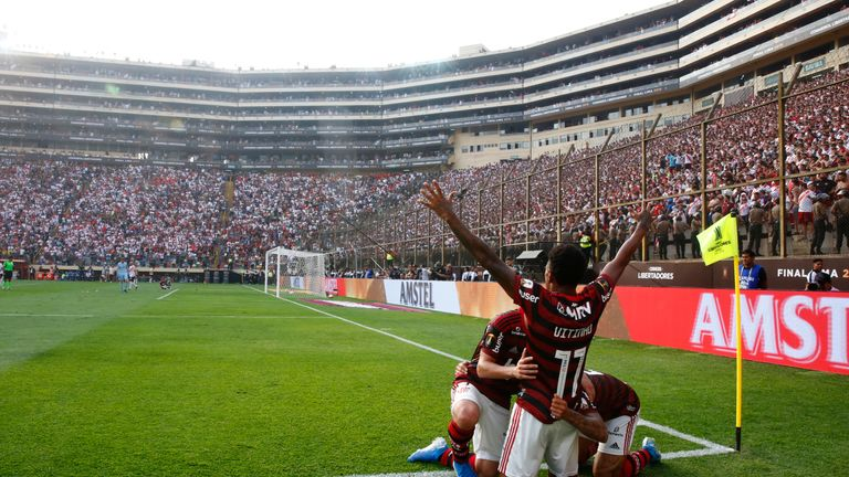 Flamengo players celebrate their last-gasp victory