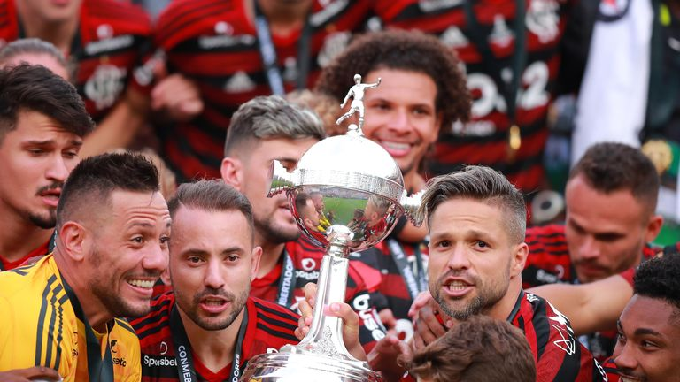 Flamengo lift the trophy after their dramatic late win