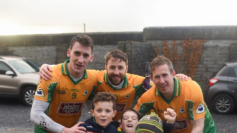 The next generation! Corofin players, Ronan Steede, Micheál Lundy, and Gary Sice celebrate with the McLoughlin brothers, Matthew, aged 8, Tom, aged 9, and Luke, aged 6 after the Galway county final