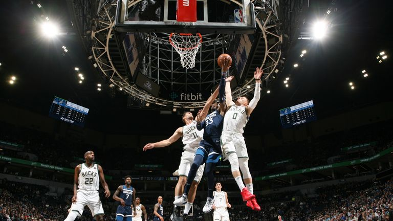 Robert Covington of the Minnesota Timberwolves drives to the basket against the Milwaukee Bucks