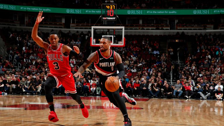 Damian Lillard #0 of the Portland Trail Blazers handles the ball against the Chicago Bulls on November 25, 2019 at United Center in Chicago, Illinois.