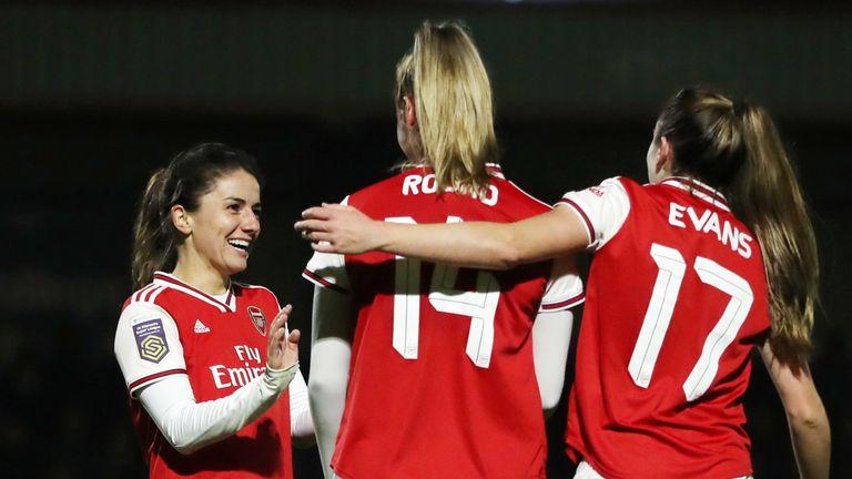 Danielle Van De Donk celebrates with team-mates Jill Roord and Lisa Evans after scoring Arsenal's sixth goal vs Slavia Prague