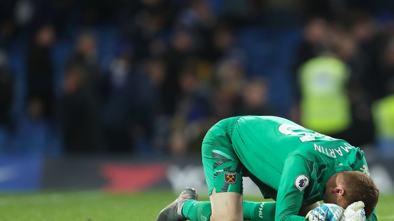 LONDON, ENGLAND - NOVEMBER 30: David Martin of West Ham United falls to the floor in celebration at full time of the Premier League match between Chelsea FC and West Ham United at Stamford Bridge on November 30, 2019 in London, United Kingdom. (Photo by James Williamson - AMA/Getty Images)