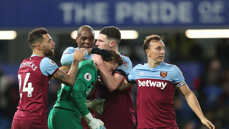 David Martin is consoled by his team-mates after winning with West Ham on his Premier League debut