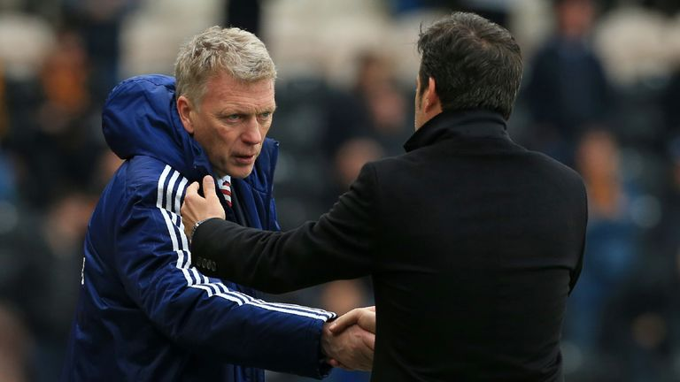 Sunderland's Scottish manager David Moyes (L) shakes hands with Hull City's Portuguese head coach Marco Silva after the English Premier League football match between Hull City and Sunderland at the KCOM Stadium in Kingston upon Hull, north east England on May 6, 2017. Sunderland won the game 2-0.
