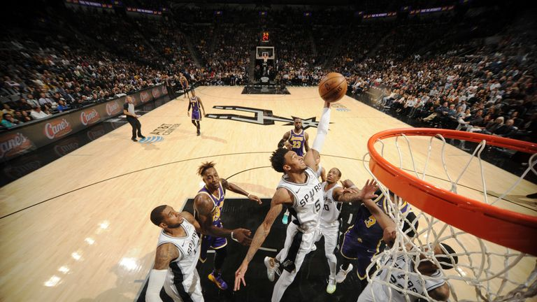 Dejounte Murray of the San Antonio Spurs grabs a rebound against the Los Angeles Lakers