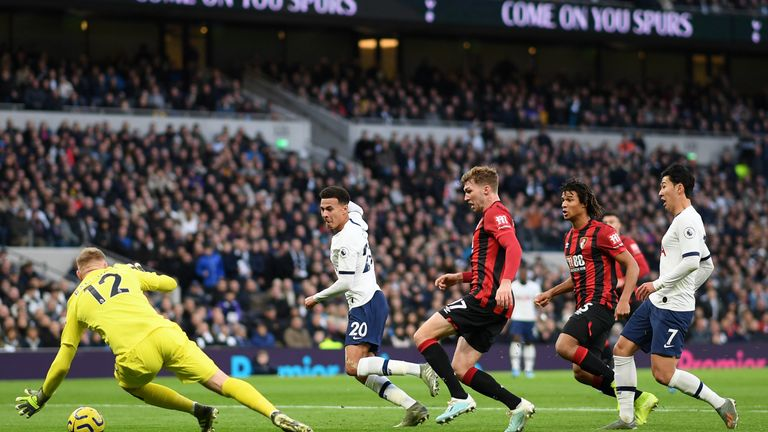 Dele Alli slides in the game's opening goal after 21 minutes against Bournemouth