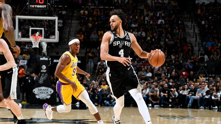 Derrick White #4 of the San Antonio Spurs handles the ball against the Los Angeles Lakers on November 25, 2019 at the AT&T Center in San Antonio, Texas.