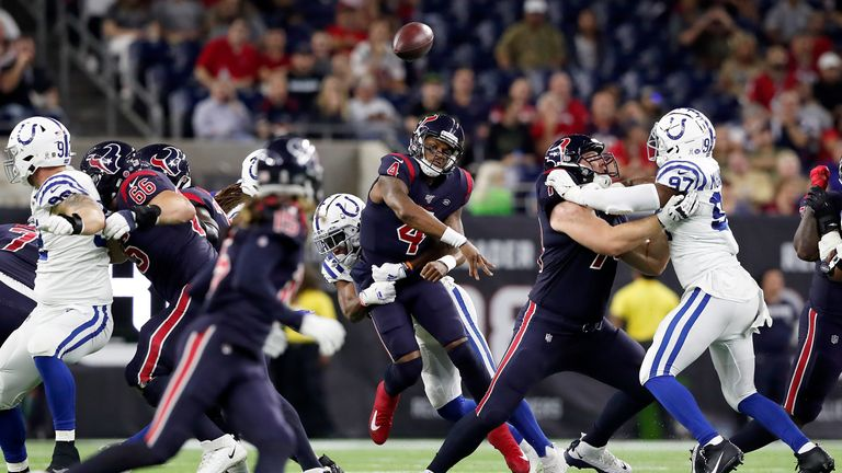 Quarterback Deshaun Watson of the Houston Texans delivers a pass over the defence of the Indianapolis Colts