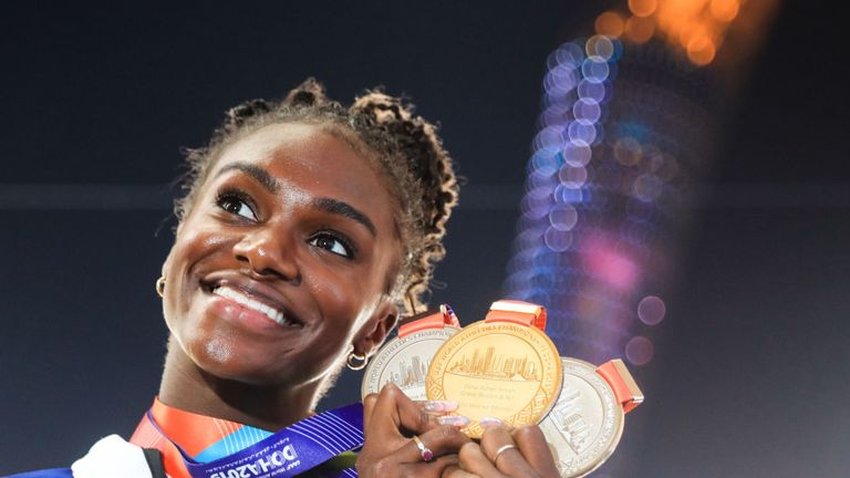 Britain's Dina Asher-Smith poses with her gold medal for the Women's 200m, silver medal for the Women's 100m and silver medal for the Women's 4x100m Relay during the medal ceremony at the 2019 IAAF Athletics World Championships at the Khalifa International stadium in Doha on October 6, 2019. (