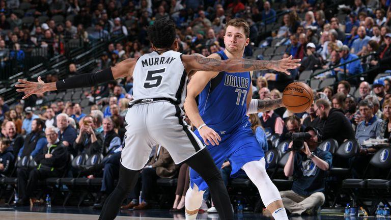 Luka Doncic of the Dallas Mavericks handles the ball against the San Antonio Spurs