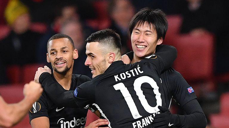 Eintracht Frankfurt celebrate a goal against Arsenal