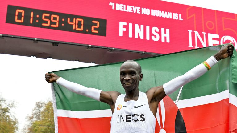 Kenya's Eliud Kipchoge celebrates breaking the mythical two-hour barrier for the marathon on October 12 2019 in Vienna.