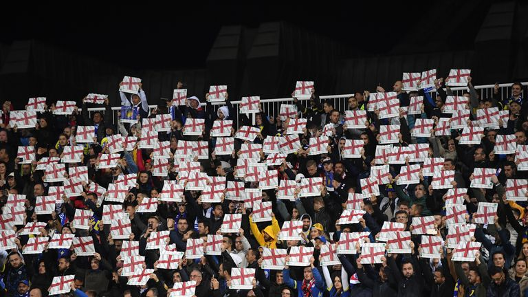 Fans hold up England flags during the UEFA Euro 2020 Qualifier between Kosovo and England at the Pristina City Stadium on November 17, 2019 in Pristina, Kosovo.