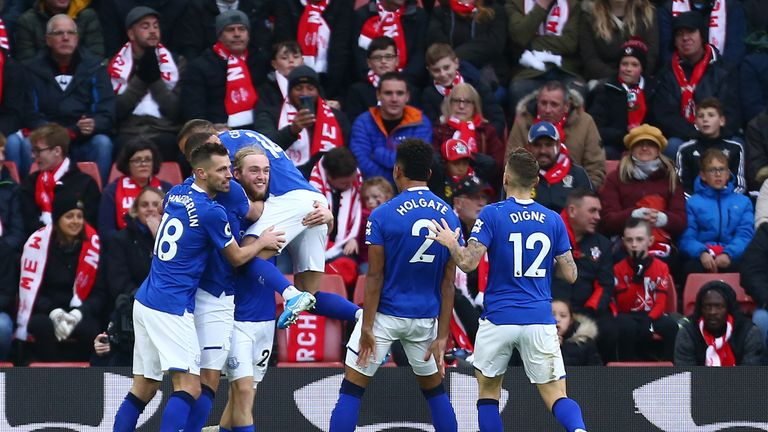 Davies is mobbed after firing Everton ahead on Saturday at Saints