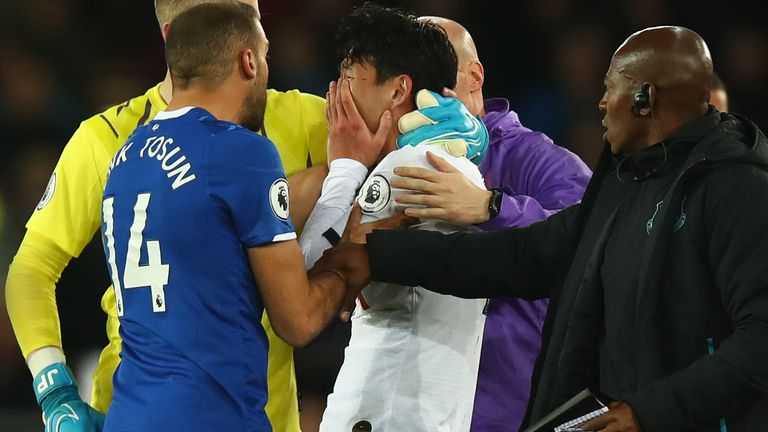 Heung-Min Son of Tottenham looks on in horror after a tackle on  Andre Gomes of Everton which resulted in a red card and Gomes suffering a serious injury