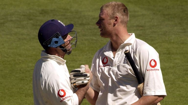 England batsman Andrew Flintoff celebrates his maiden test century with Graham Thorpe during the Third day of the First Test between New Zealand and England in March 2002.