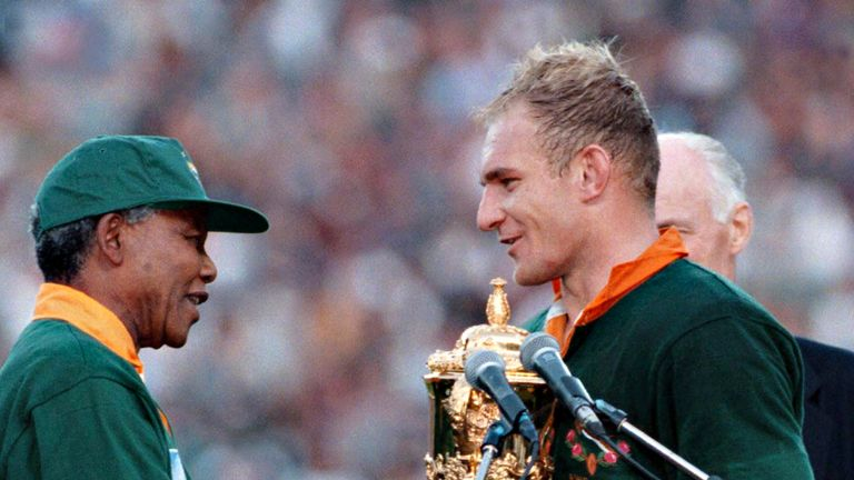 Francois Pienaar receives the Rugby World Cup from Nelson Mandela in 1995