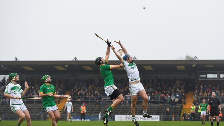 Get up there! Brian Cody of Ballyhale Shamrocks and Luke Folan of Clonkill compete for a high ball