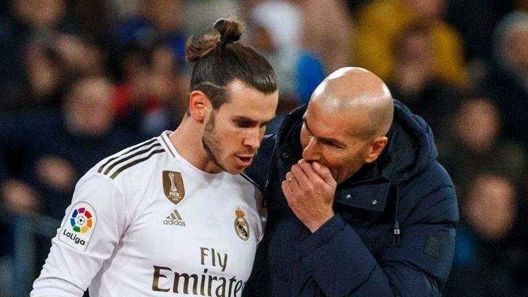 Gareth Bale of Real Madrid speaks with Zinedine Zidane of Real Madrid during the La Liga match between Real Madrid CF and Real Sociedad at Estadio Santiago Bernabeu on November 23, 2019 in Madrid, Spain.