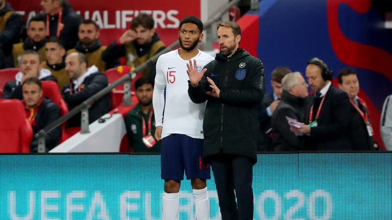 Gareth Southgate gives instructions to Joe Gomez as he prepares to come on as a substitute vs Montenegro