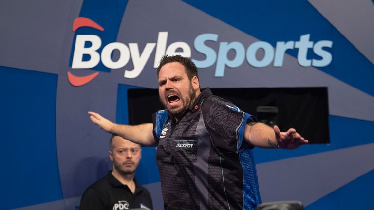 Adrian Lewis booked his place in the knockout stages of the Grand Slam of Darts with a win over Jim Williams