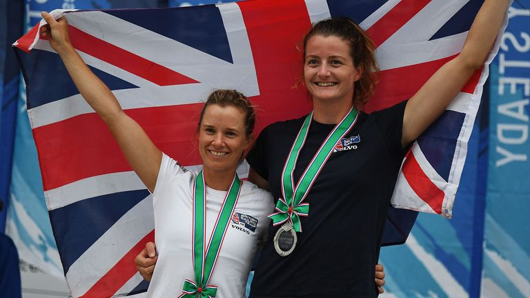 Britain's Hannah Mills and Eilidh McIntyre celebrate second place during the awards ceremony for the women's two person Dinghy 470 class medal competition at a sailing test event for the Tokyo 2020 Olympic Games, at Enoshima Yacht Harbour in Kanagawa Prefecture on August 22, 2019.