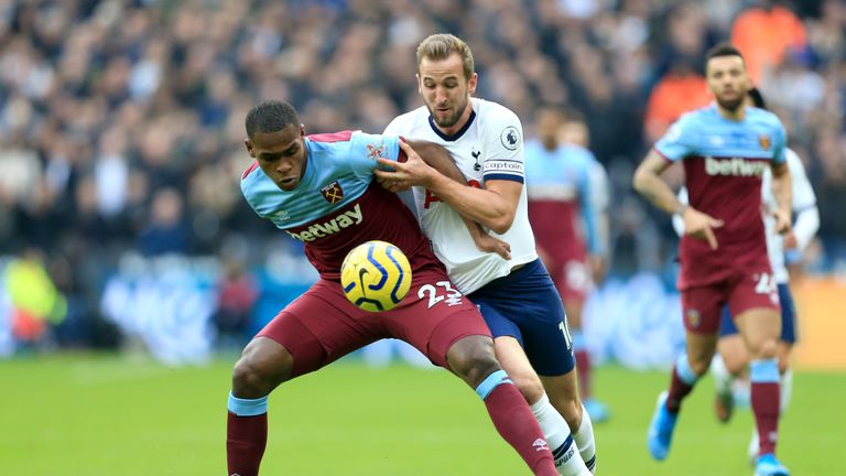 Harry Kane tussles with Issa Diop at the London Stadium